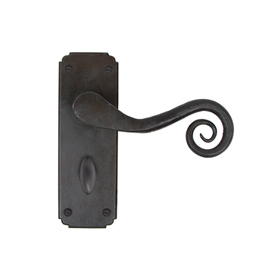 From The Anvil 33902 - Beeswax Unsprung Monkeytail Lever on Bathroom Backplate